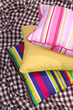 Three Various Pillows On Plaid