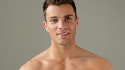 Close up Portrait of Caucasian Male Model Posing on Gray