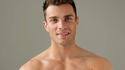 Close up Portrait of Caucasian Male Model Posing on Gray
