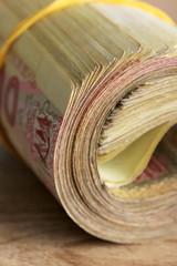 Ukrainian money on wooden background