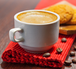 Coffee cup and cookies on a table