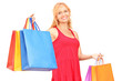 A mature woman posing with shopping bags