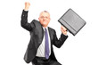 A happy mature businessperson with raised hands and briefcase