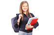 A female student with backpack holding notebooks