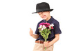 A cute little boy with a hat holding bunch of flowers