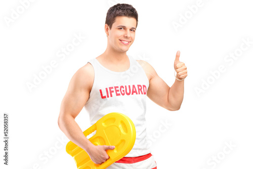 A happy lifeguard on duty giving a thumb up