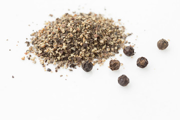 Roughly ground and whole peppercorns