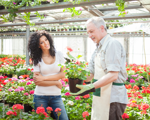 Greenhouse worker talking to a customer