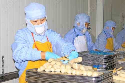 workers in the food processing production line in a factory