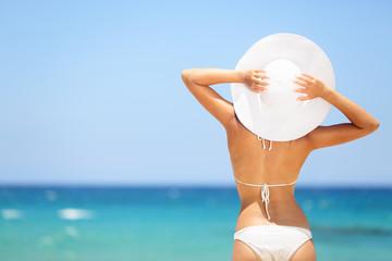 Woman enjoying beach relaxing in summer