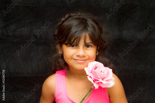 Girl posing with flower