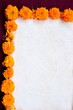 Frame of marigold on exotic dark red background