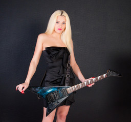 Sexy woman in dress with electric guitar