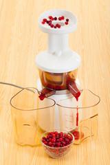 slow juicer making cranberry juice