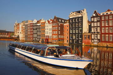 Amsterdam with tourist motor boat in Holland