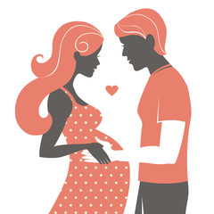 Silhouette of couple. Pregnant woman and her husband