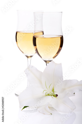 Flower of lilly and two champagne glasses