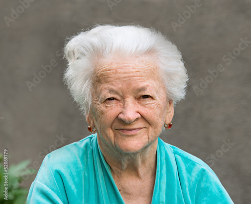 Smiling woman on a gray background