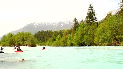 Kayakers on the river in spring.