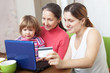 Happy family  paying by credit card in internet store