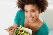 African American Woman Eating Salad - 52071598