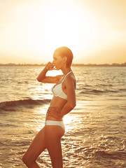 Girl standing in the sea side view
