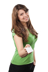 Attractive young woman offers a business card