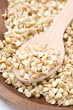 green sprouts buckwheat in wooden bowl closeup