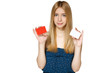 Teenager female holding two blank credit cards