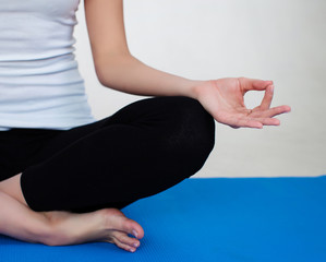 cropped half-image of yoga Sukhasana pose
