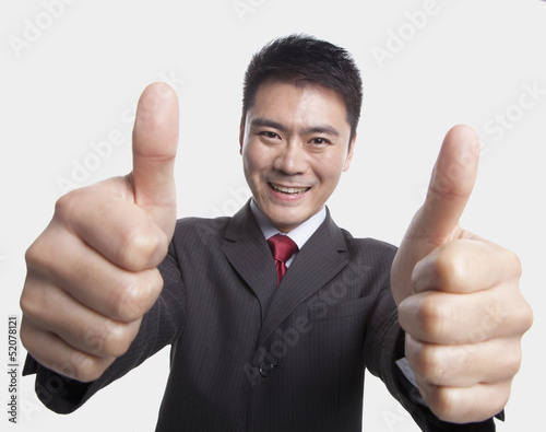 Businessman Giving Thumbs-Up