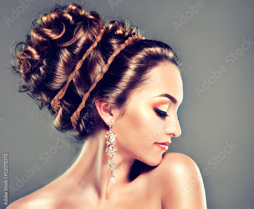 Model with Coral makeup and Greek Hairstyles