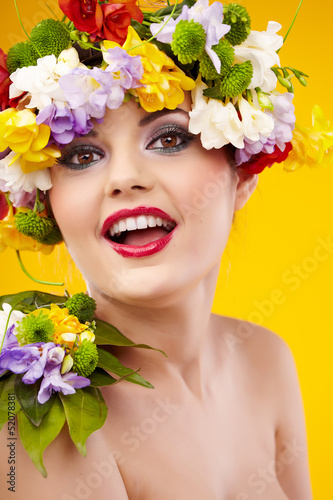 The attractive girl, front portrait, on a head a flower wreath