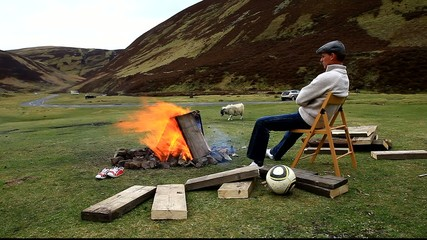 man chilling around camp fire wanlockhead scotland