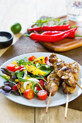 Grilled chicken skewer with salad
