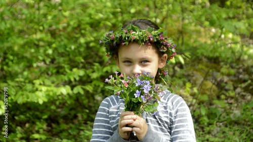 little girl with a wreath of flowers