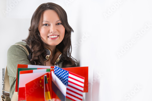 Portrait of a lovely young woman with different countries flags