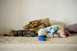 Toddler and cat sleeping together