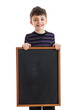 Nine year old boy holding a blank chalkboard