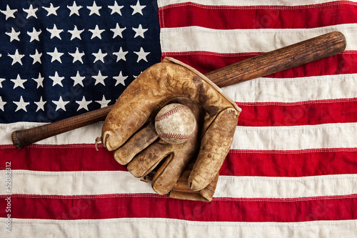 Vintage baseball, bat and glove on American flag