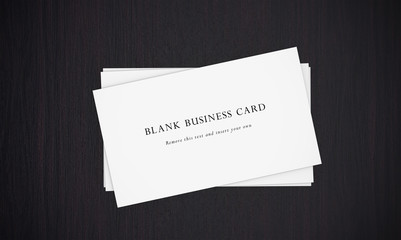Business cards on dark background.