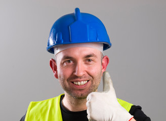 Portrait of a worker expressing positivity with ok symbol
