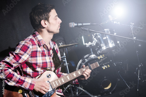 Man playing guitar during concert