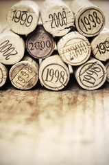 Vintage corks on wood, copyspace