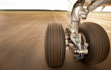 Landing gear, wheels, on the runway, close up