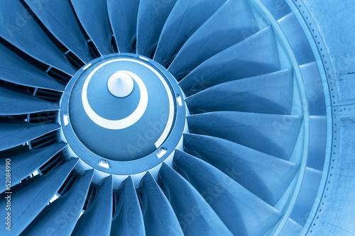 Papiers peints Avion à Moteur Titan blades of jet plane engine, blue light