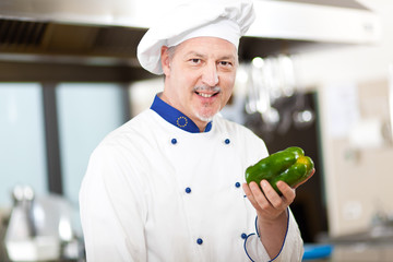 Chef holding a pepper