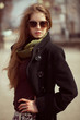 Stylish girl with long hair wearing sunglasses