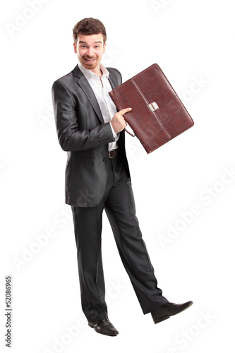 Businessman with briefcase standing on white background