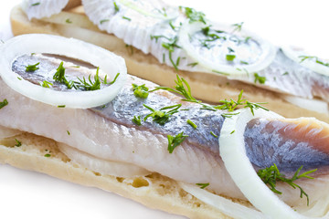 Sandwiches with herring, onions and herbs, isolated, closeup